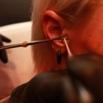 schieten of piercen